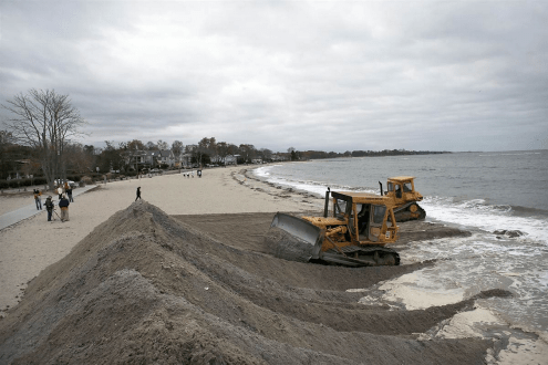 Workers shoring up the beach