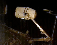 Dragon capsule tethered to ISS