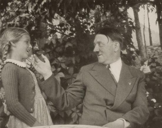 Hitler always looked creepy when he was with kids