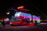 Bright lights illuminate a vehicle at Burning Man 2013