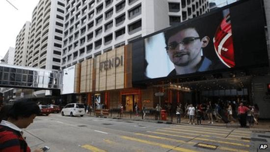 Edward Snowden on video board in UK