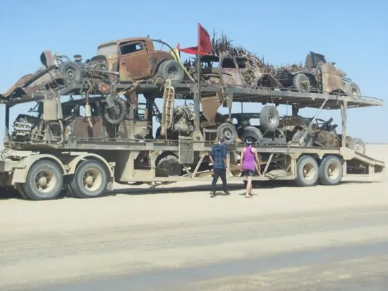 Destroyed cars being hauled away after filming of Mad Max Fury Road
