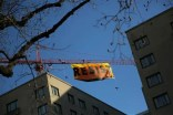 RESIST flag hanging from crane