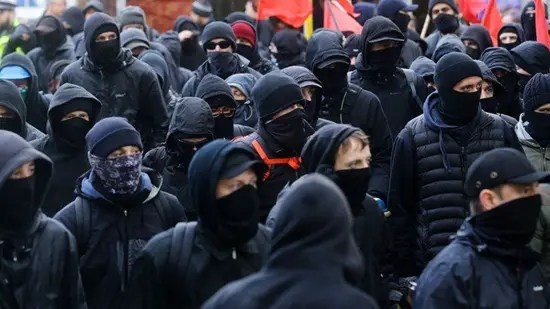 Black block and Antifa dress for tactical concealment and identification.