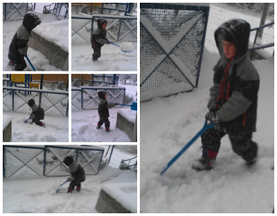 POD: Jacob shovels the falling snow