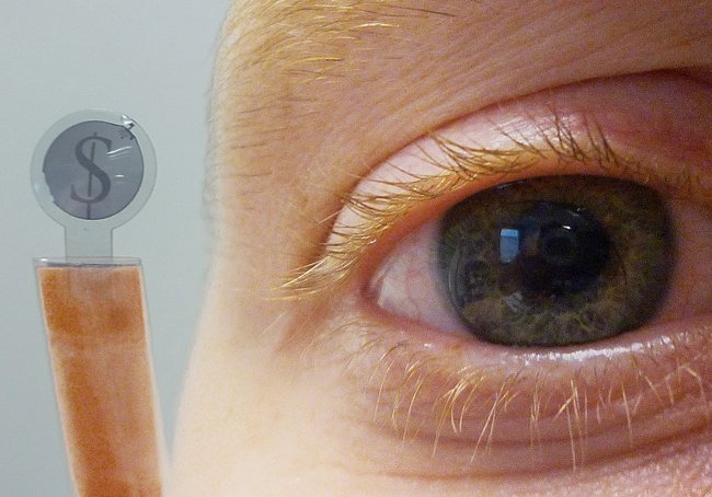 Contact Lens Prototype Equipped With Embedded LCD Display