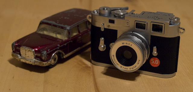One is an expensive replica of a German classic with some amusing working features. The other is a Minox digital camera.