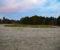 SKYTEBANEN: Arealet ønskes både som parkeringsplass for Raet nasjonalpark og til bobilparkering. Det er staten som er grunneier av eiendommen Flatemo ved Tromøy kirke. Arkivfoto