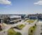 TO BATTERISATSINGER: Morrow Batteries vil bygge innovasjonssenter i Grimstad, lokalisert ved Universitetet i Agder, mens pilotfabrikken skal bygges i Arendal. Illustrasjon: ENO Arkitekter, No Sleep Till Brooklyn, J.B. Ugland Eiendom