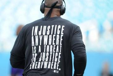 Cam Newton usa camiseta com frase de Martin Luther King antes de jogo