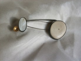 3. (the logos after the tide) exchange. brooch. stone, gold, mother-of-pearl, oxided silver
