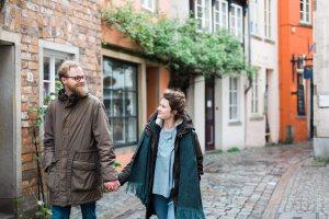 Couple walking Bremen streets in Germany