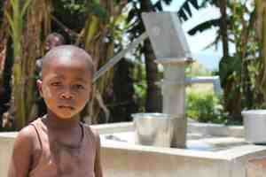 Young Boy at Water Well
