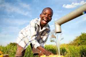 Boy getting clean water
