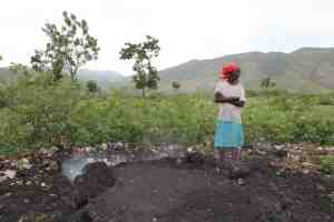 Haitian Woman Making Charcoal