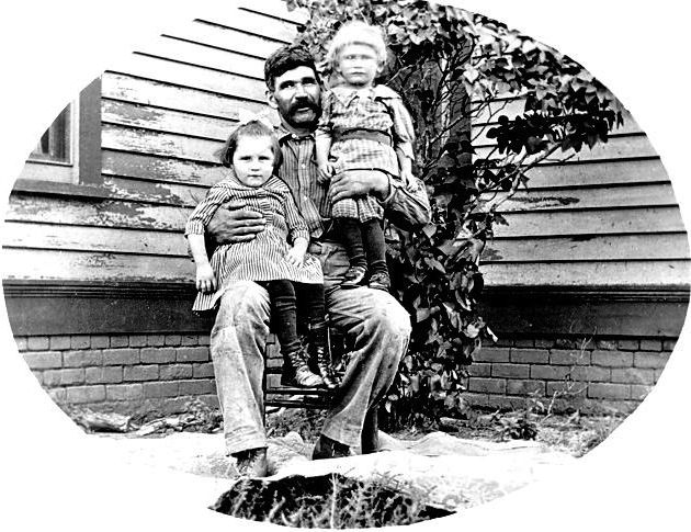 Joseph Vanek with his and Anna's youngest children, Mary and Herman, ca. 1915.