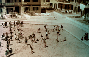 Frame from Case per il popolo with children playing in the new Quadraro neighbourhood of the INA-Casa Plan (1953)