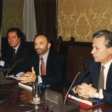 Communication manager Armando Zimolo (left) and deputy general manager Benito Pagnanelli (right) receive the first Italian astronaut, Franco Malerba, insured by the Company (Rome, December 14, 1993)