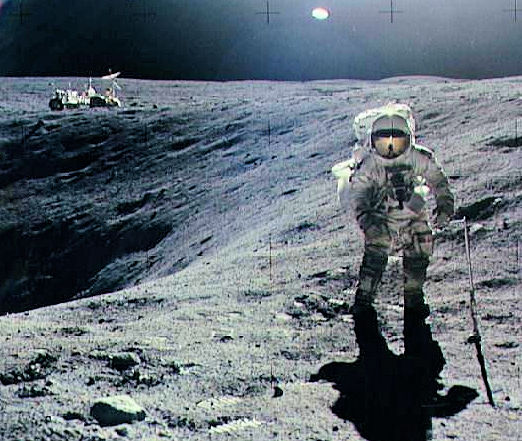 Apollo 16 lunar module pilot Charles Duke collects samples near the rim of Plum Crater, a 33-foot-deep (10-meter-deep) depression on the moon's surface. Launched on April 16, 1972, Apollo 16 was the fifth mission to land men on the moon.