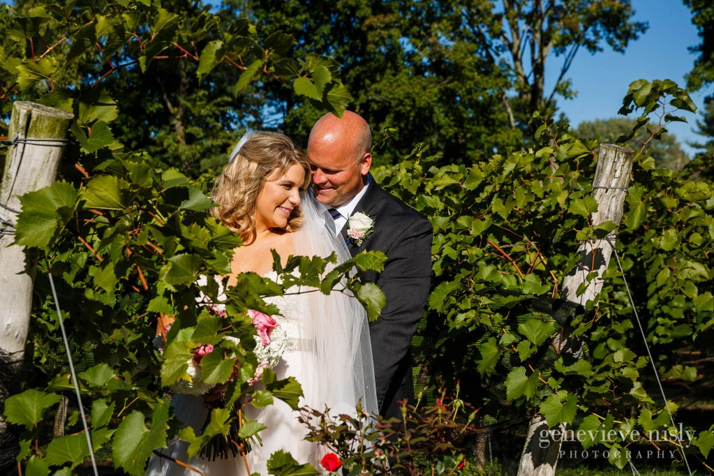 Bride and groom surrounded by vines during a wedding at Gervasi Vineyard in Canton, Ohio by Cleveland wedding photographers Genevieve Nisly Photography.