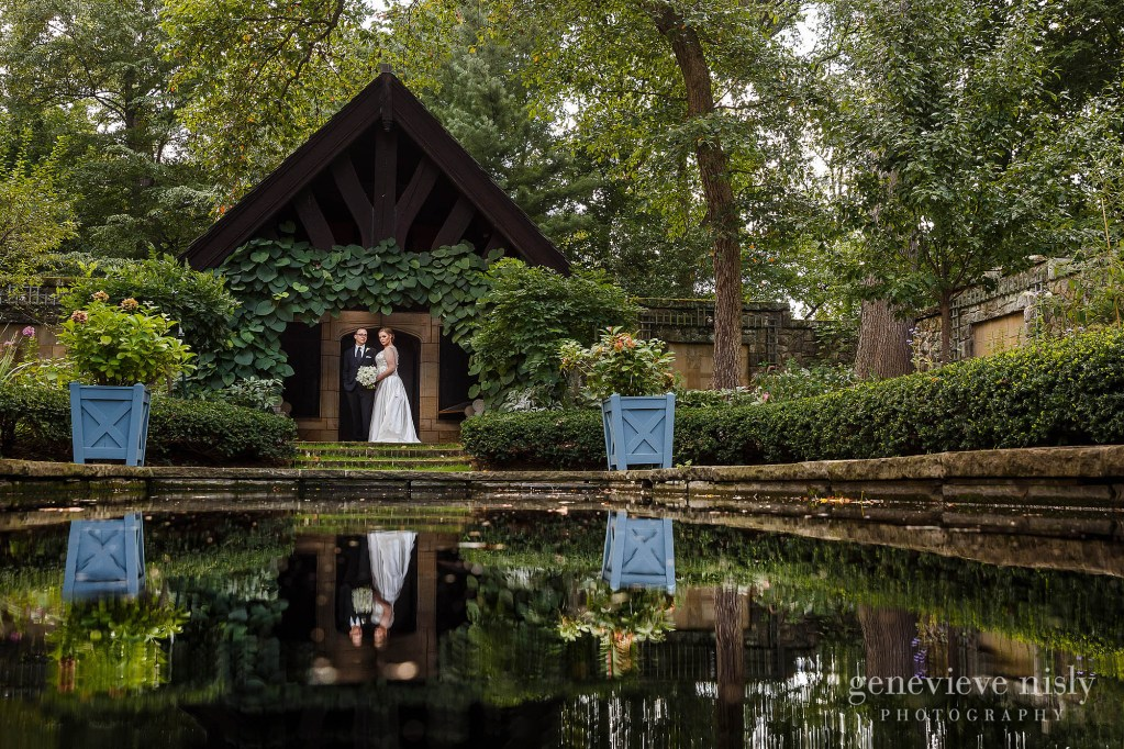Bride and groom reflecting off the water in the English Garden during their wedding at Stan Hywet Hall and Gardens.