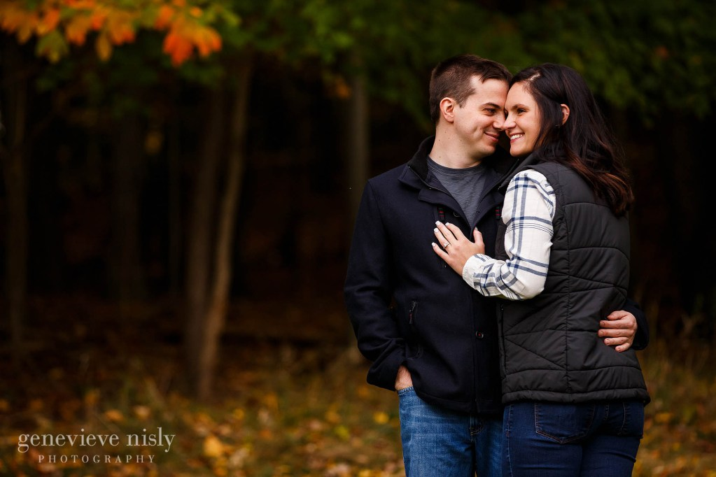 Gabby and Jordan in their back yard during a fall engagement session in Cleveland, Ohio.