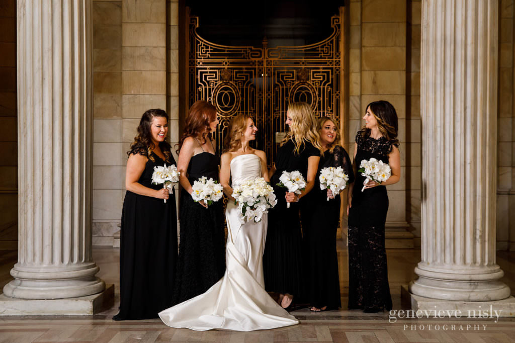 Bridesmaids in front of an iron grated door.