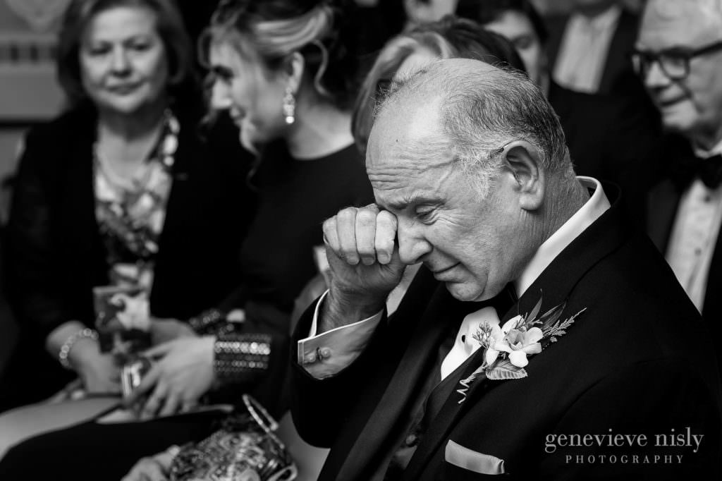Dad wipes his eye during the wedding ceremony.