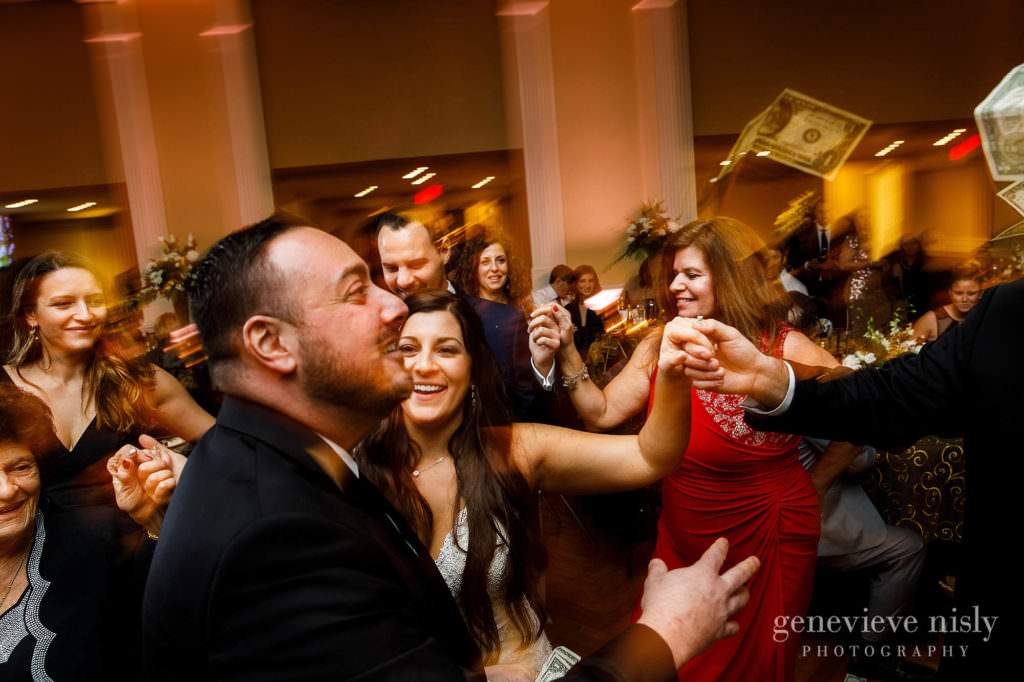 Guests dance at party on the dance floor during the reception.