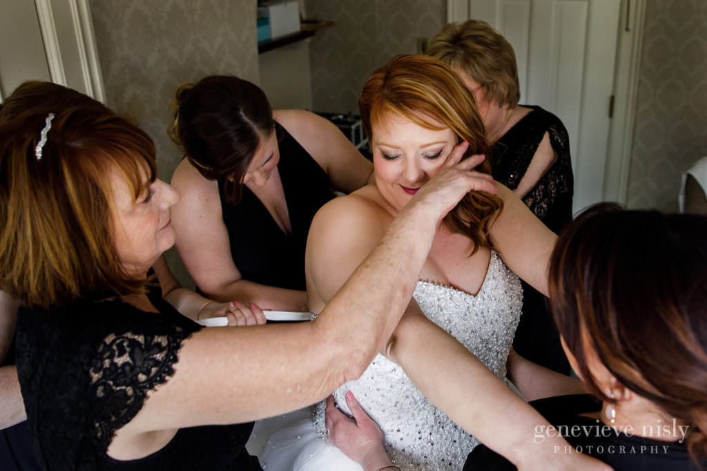 The bride and her mom get emotional while puts her wedding dress on at the Mooreland Mansion.