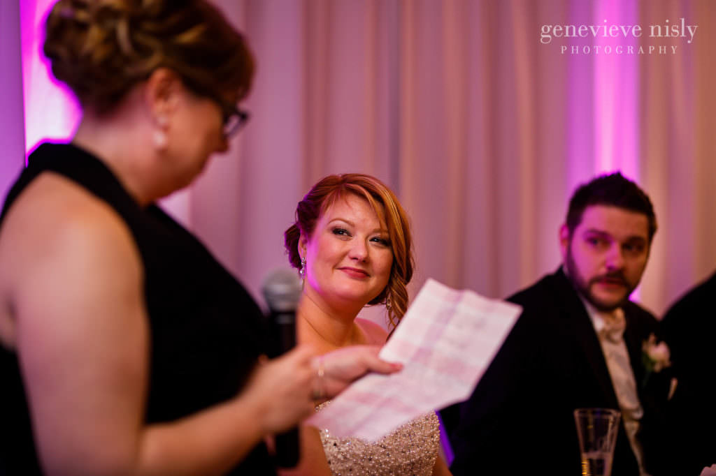 The bride lovingly smiles at her sister during her toast at the Cleveland Holiday Inn.