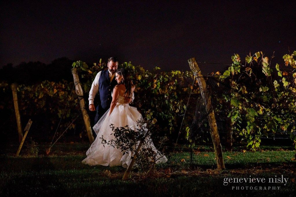 Ryan and Jennifer in the vineyards at night during their wedding at Gervasi Vineyards in Canton, Ohio.