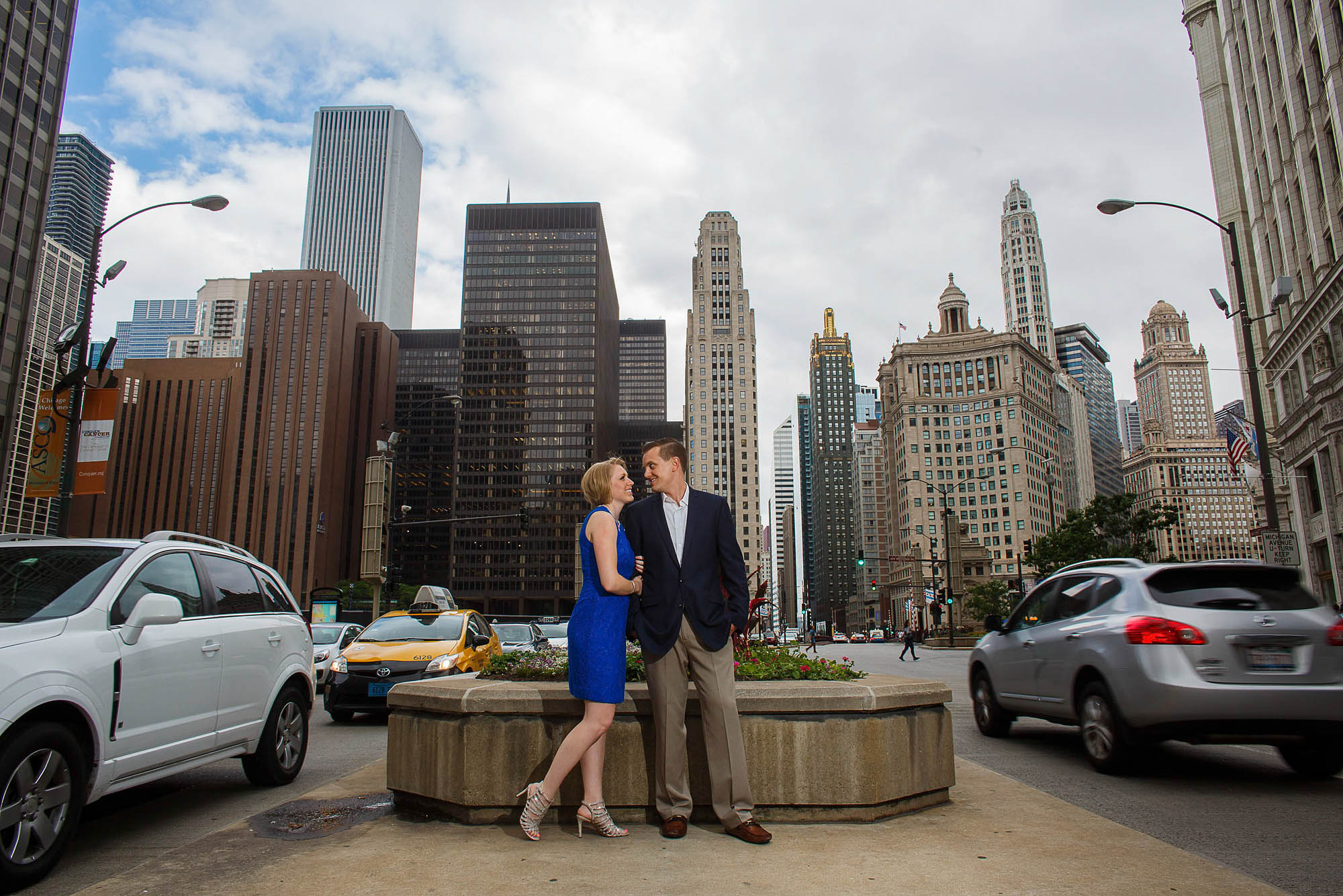 Engaged couple on Michigan Avenue in Downtown Chicago, Illinois.