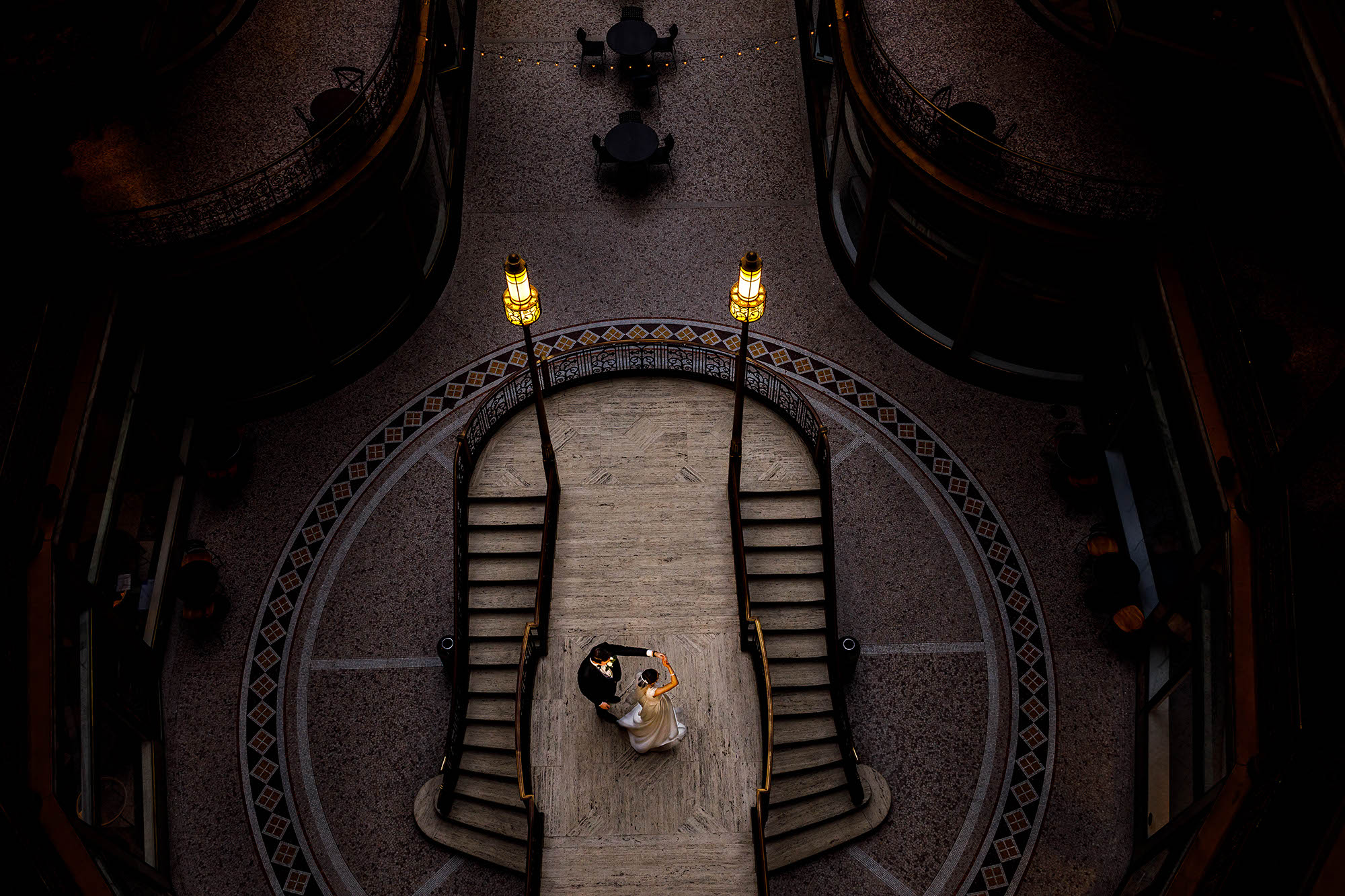 The groom twirls his bride on the landing of the ornate staircase in Cleveland's Historic Arcade located between Euclid Avenue and Superior Avenue.