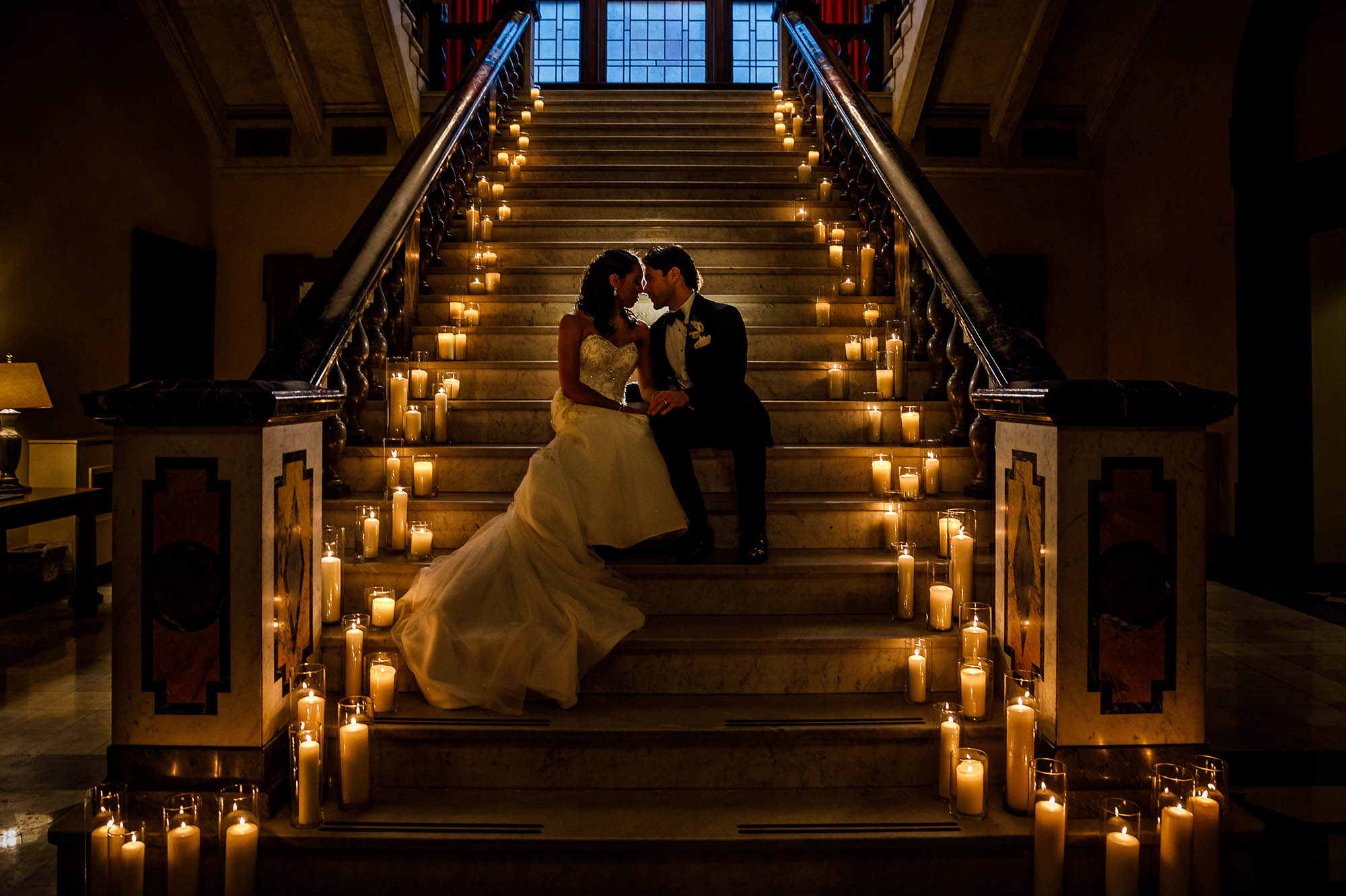 Monique and Tim sit for a romantic portrait after tying the knot on the candlelit steps of the Union Club in Downtown, Cleveland.