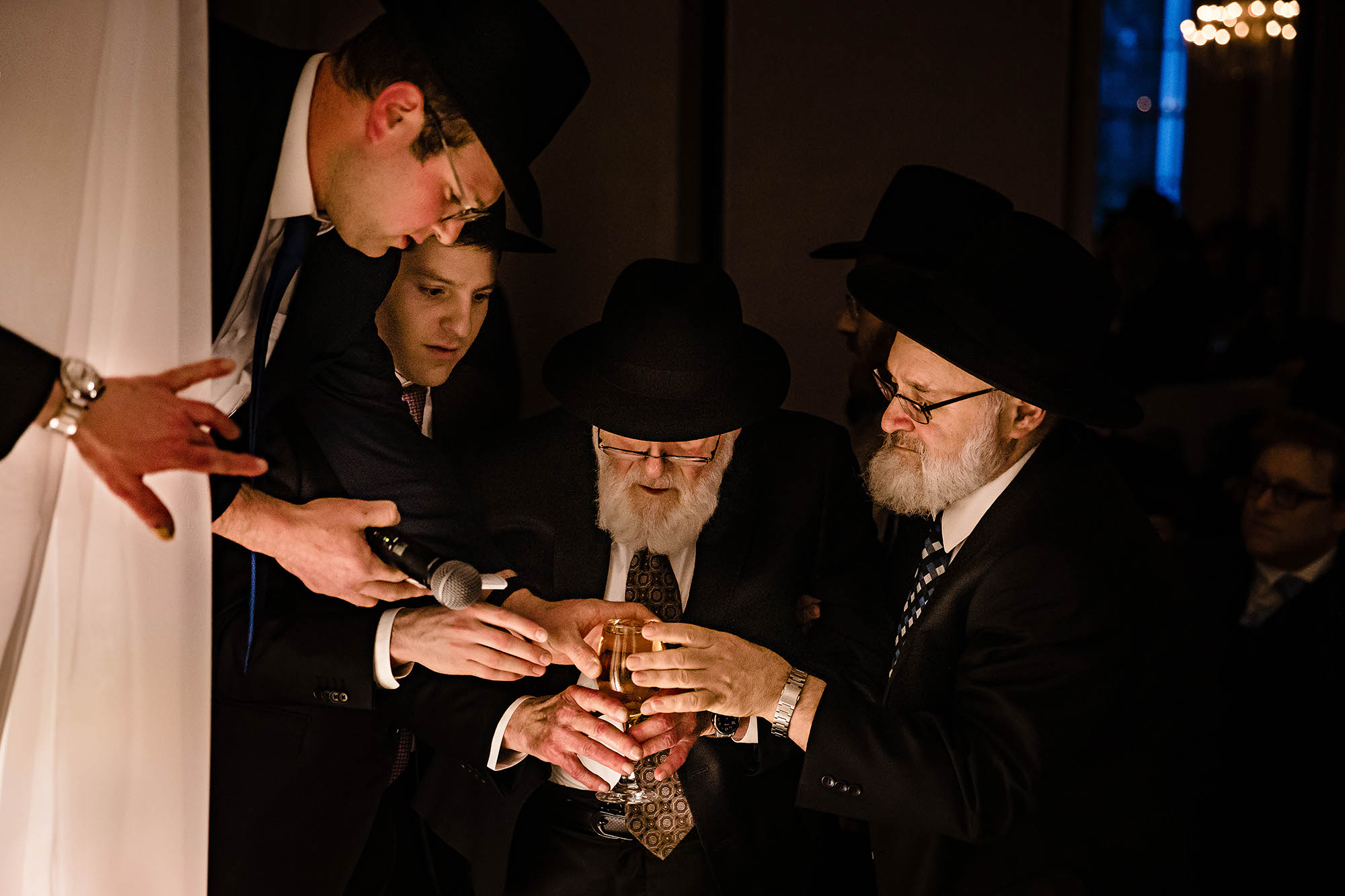 The rabbis bless the wine during the orthodox Jewish wedding ceremony at Landerhaven in Cleveland, Ohio.
