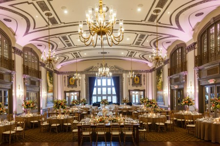 A elegant wedding reception in the Crystal Ballroom at Tudor Arms Hotel in Cleveland, Ohio