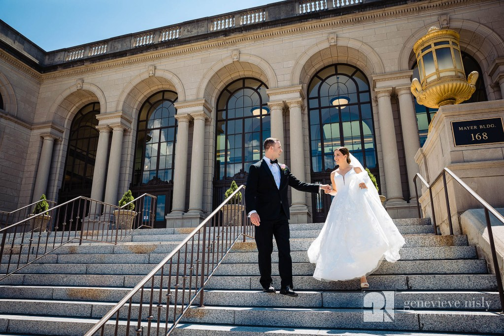 Ali and Jason walk down the post office steps in Downtown Akron on their wedding day.