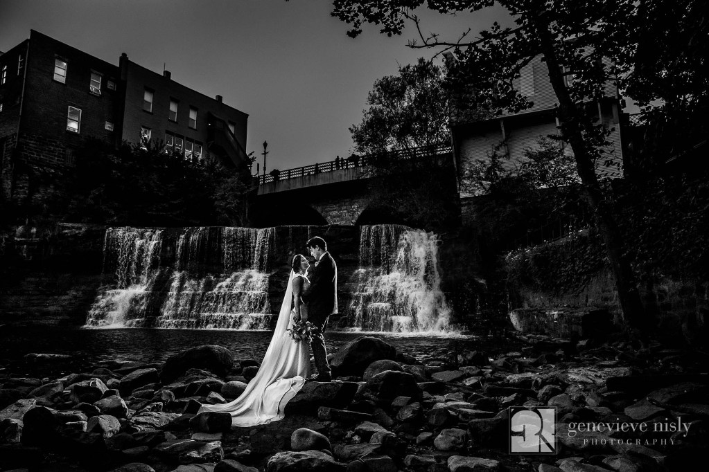 Chagrin Falls wedding portrait of a bide and groom down by the falls.