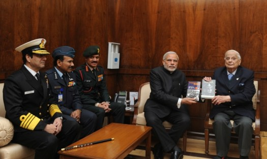 Jacob (far right) presents his books to Prime Minister Narendra Modi. Three Chiefs (Army-Air Force-Navy) are also present. Image via Wikimedia Commons. CC BY-SA 3.0