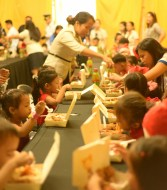 Kids enjoy hearty meals at the ChriSMiles activity.