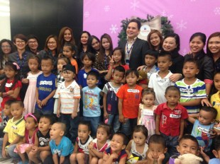 ChriSMiles beneficiaries with SM Lanang Premier employees and SM VP for Mindanao Operations Oliver Tiu (5th from left)