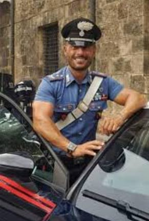 Another Italian policemen in light blue uniform. Oh my.