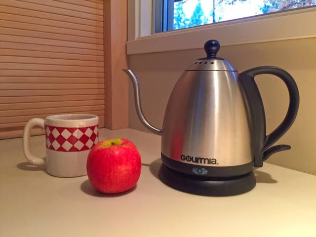 Teapot on my counter with cup and apple for decoration