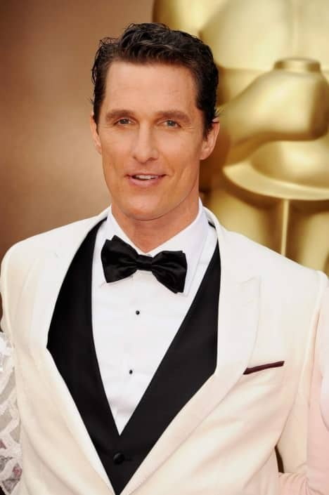 Matthew McConaughey in off white dinner jacket that looks like it came right from the rental department