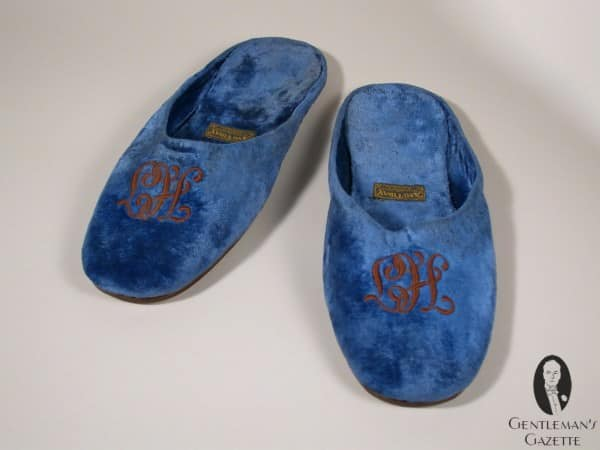 Monogrammed velvet slippers of Truman - note the HT is engraved upside down