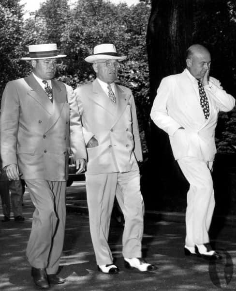 Truman in 4x2 summer suit with spectators