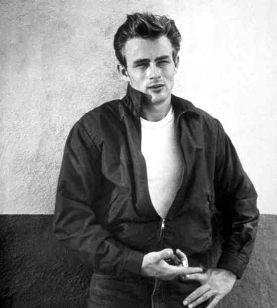 Dean in an iconic publicity still from Rebel Without a Cause, wearing his signature red Harrington jacket.