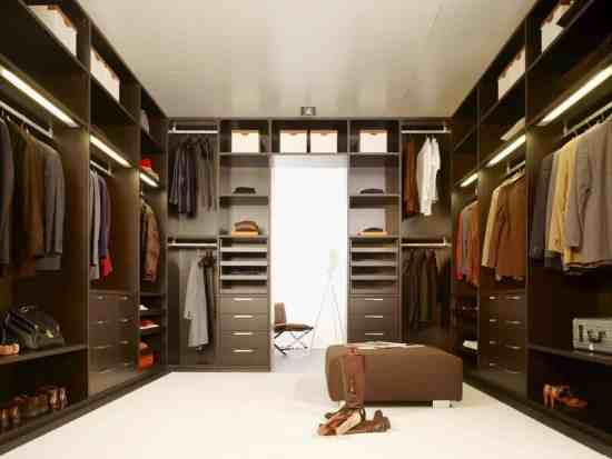 Large Closet with carpet and special hangers that allow even shorter people to hang their clothes on the top rack