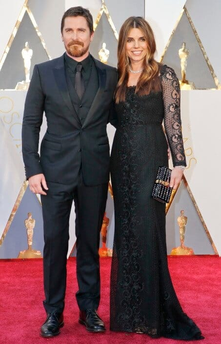 Christian Bale once again in monochromatic all black with necktie